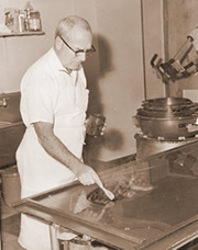 Walter Sweenor makes hard candy in the 1960s.
